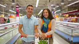 Cheerful Couple Spending Their Weekend Doing Shopping Together Footage
