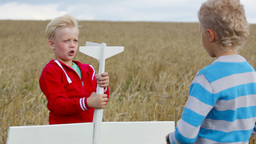 Rural Boys Playing Outdoors With A Wooden Plane Footage