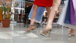 Close-Up Of Shopping Girls Marching In The Mall Footage