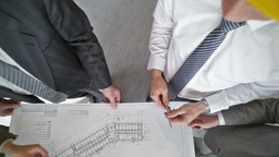 The Above View Of An Engineering Team Discussing The Blueprint stock footage