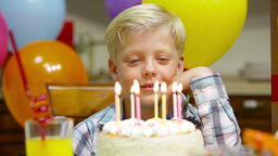 Sad Little Boy Celebrating His Birthday Alone Suddenly Cheering Up And Blowing T Footage