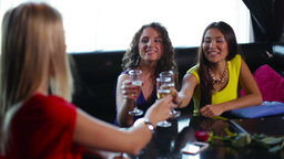 Happy Young Women Enjoying Themselves In The Restaurant, Their Friend Having A B Footage