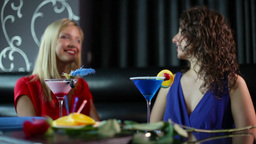 Young Women Having Fun In The Club, Focus Shifting From A Champagne Flute To The Footage