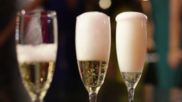 Close-Up Of Three Flutes Being Filled With Sparkling Wine Footage