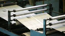 Fast Process Of Black-And-White Newspaper Sheets Passing The Offset Cylinders Footage