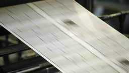 Continuous Newspaper Sheet Moving Fast Along The Line Of The Printing Machine Footage