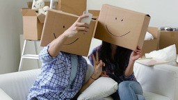 Happy Move-Ins Pillow Fighting Then Taking Picture Of Themselves In Boxes With D Footage
