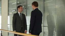 Two Businessmen Meeting And Talking Then Going Away In The Office Building Footage
