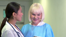 Lovely young doctor showing promising test results to her elderly patient Footage