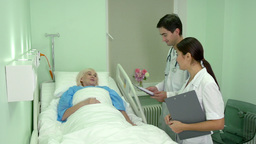 Medical Team Visiting Their Retired Patient Who Is Feeling Better stock footage