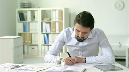 Young businessman doing paperwork in an office Animation