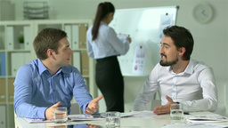Young businessmen discussing in an office Animation