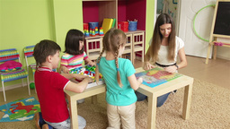 Group of children making puzzle together Animation