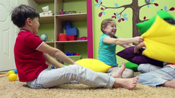 Slow-motion of cute children pillow fighting Animation