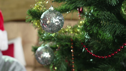 Close-up of children decorating Christmas tree with baubles Footage