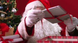 Santa Claus packing presents for Christmas Animation