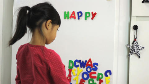 Asian Girl Spelling Happy Birthday On Fridge Footage