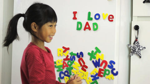 Little Asian Girl Spelling I Love Dad On Fridge Footage