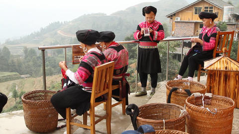 Yao ethnic minority women embroidering in outdoor Footage