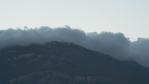 The Movement Of Clouds In Mountains (Timelapse) stock footage