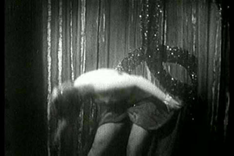 A dancer performs at a burlesque club in this 1930 Live Action