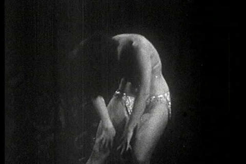 A stripper performs a striptease at a burlesque cl Live Action
