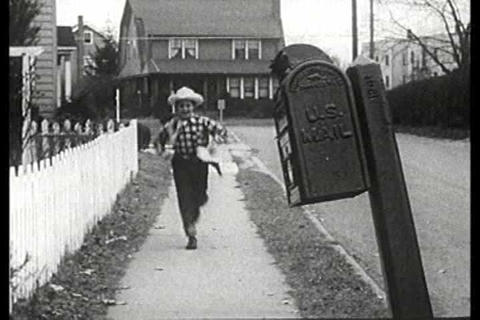 A boy dressed as a cowboy sends of a letter to Hop Footage