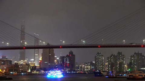 busy shipping on river at night,across the sea bridge,Brightly urban building Animation