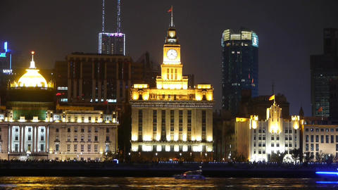 time lapse,Brightly lit ships cruising Shanghai Bund at night,old style building Animation