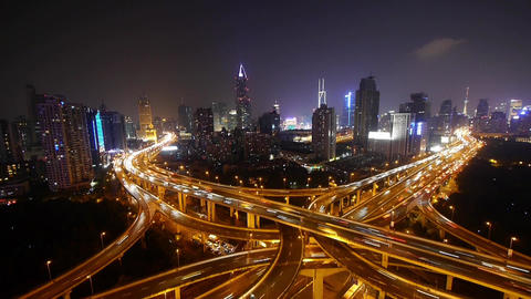 timelapse of driving & cars racing by with streaking lights trail at night Animation