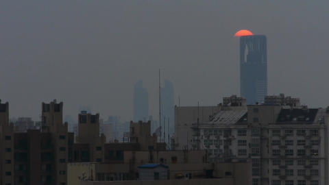 timelapse unsets behind urban with business building silhouette,shanghai,china Animation