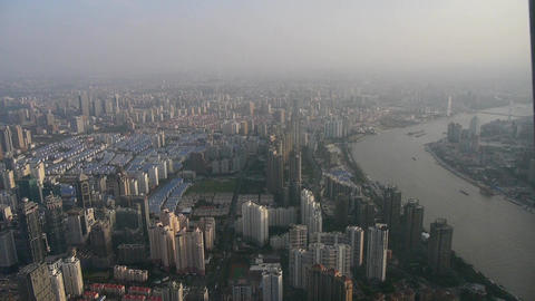 aerial view of high-rise buildings with river in Shanghai,China,time lapse Animation
