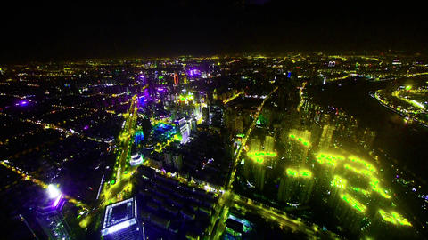 aerial view of brightly lit buildings with river in Shanghai at night,timelapse Animation