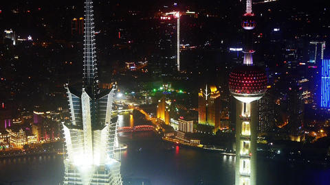 aerial view of skyscraper rooftop crown with river in Shanghai at night,China Animation