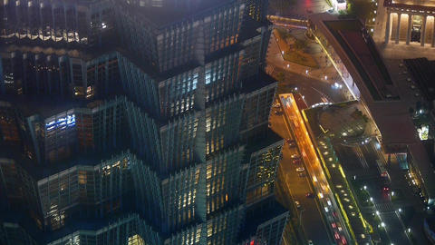 aerial view of highrise buildings & urban traffic at night,time lapse Animation
