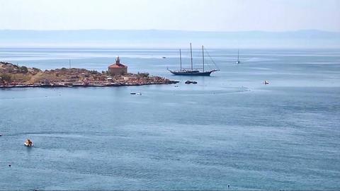 Sailing yacht near the lighthouse Footage