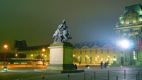 Time lapse from the Louvre at night with statue Footage