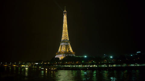 Eiffel Tower in Paris night lights view from Bir H Footage