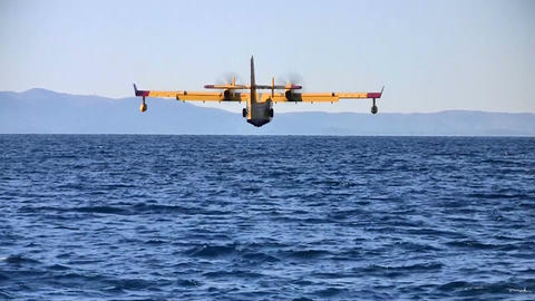 Fire fighter airplane landing at sea Footage