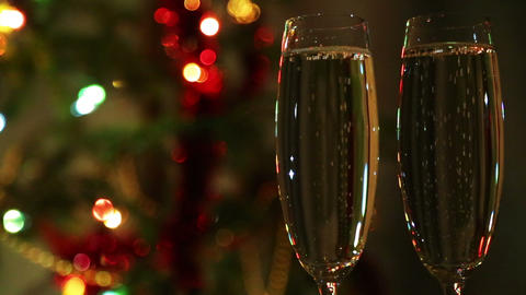 Glasses With Champagne Against Festive Lights Back stock footage