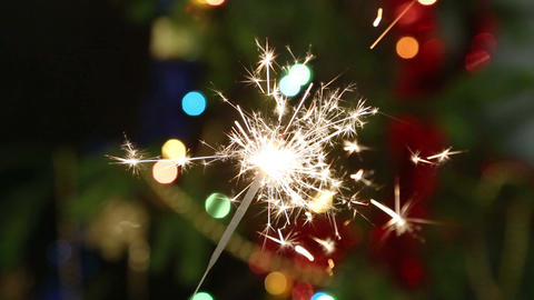 sparkler burning on background decorated Christmas Footage