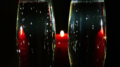 glasses with champagne and candle - romantic eveni Footage