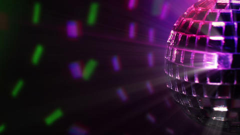 Colored dark background and disco ball Footage