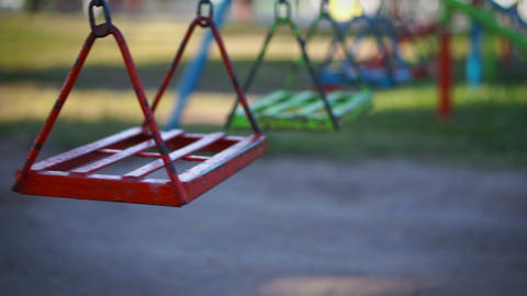 Empty swing in a children's playground Footage
