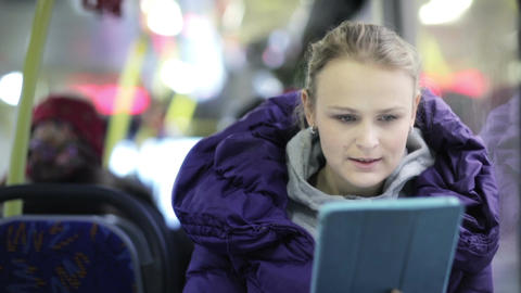 Woman With Touchpad In The Bus stock footage