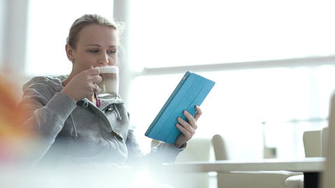 Woman in cafe using her touchpad Footage