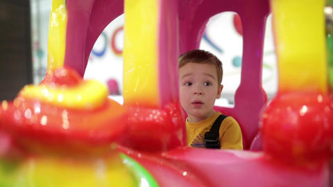 Boy in amusement train Footage