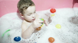 Boy playing in the bath Footage