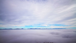 Timelapse scenery with clouds and layer of fog Footage