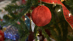 Bauble and Decorations Hanging on a Christmas Tree Footage